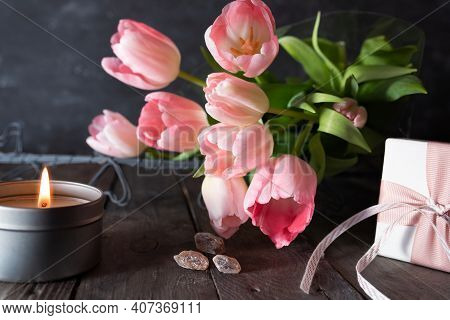Mothers Day Still Life With Bouquet Of Pink Tulips And Gift On Dark Vintage Wood. Background With Sh