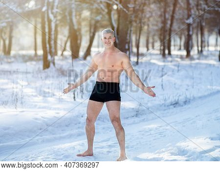 Full Length Portrait Of Handsome Senior Man Exposing Himself To Cold Weather, Standing In Underwear