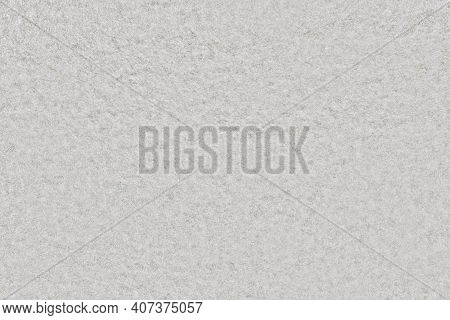 Texture Of White Foam Material. Background Felt Of Grey Fabric With Uniform Pattern