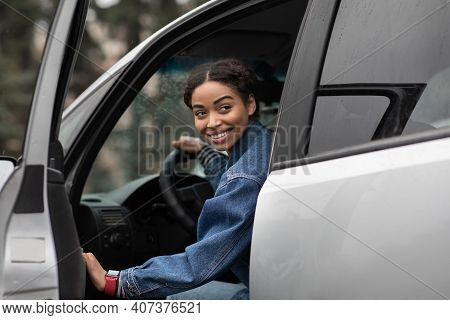 Are You Going With Me. Friendly Smiling Millennial African American Female Driver Opens Door And Loo