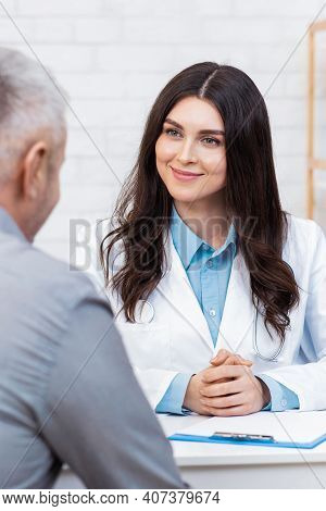 Health Care, Modern Family Doctor And Medical Examination. Smiling Friendly Young Woman In White Coa