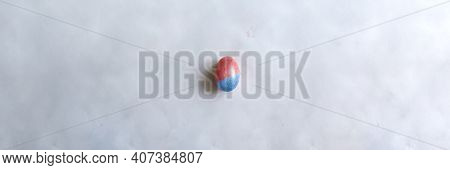 Red Easter Egg On Paper Gray Background With Copyspace. Banner Of Macro Moody Minimalistic Decoratio