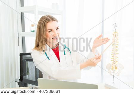 A Female Beautiful Doctor Is Wearing A Doctor Uniform Currently Recommending Treatment Using A Verte