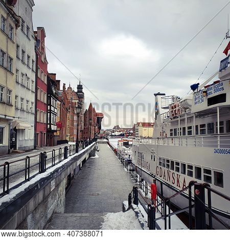 Gdansk, Poland - February 7, 2021: Old Town Of Gdansk In Poland With Motlava River, Poland. Winter S