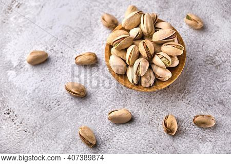 Organic Pistachio Nuts In Bowl On Table.