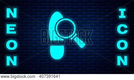 Glowing Neon Magnifying Glass With Footsteps Icon Isolated On Brick Wall Background. Detective Is In