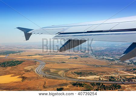 Airplane takeoff from Madrid Barajas over golden wheat fields poster