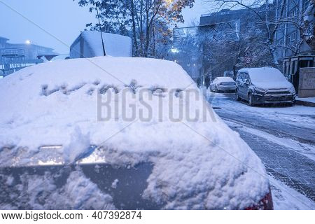 Town Covered By Snow And Winter Handwriting On Window Of A Car In Winter Time Selective Focus
