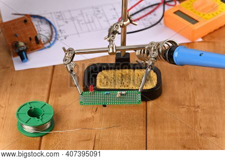 Electronic Circuit Board In Helping Hand, Close Up.