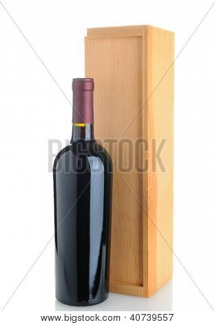 A Cabernet Sauvignon wine bottle standing in front of a wood box. Isolated on white with reflection.