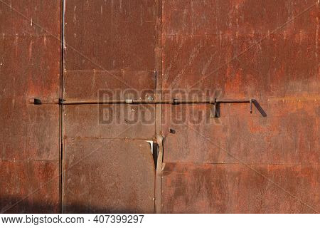 Old Rusty Door Of An Old Factory