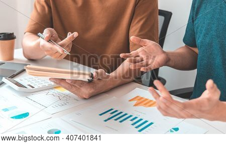Meeting A Team Of Undercover Businessman, Executives And Accountants Meeting About The Company's Rev