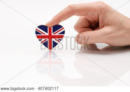 Love And Respect Great Britain. A Man's Hand Holds A Heart In The Shape Of The Britain Flag On A Whi