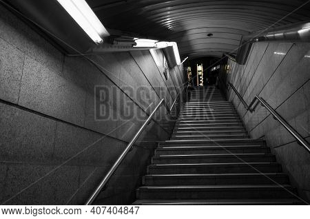 Empty Dark Underpass Perspective. Stone Stairs Go Up Under White Neon Lights. Abstract Night City Ba