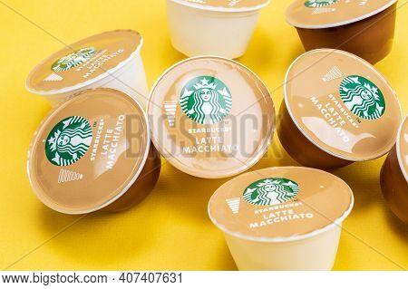 Tyumen, Russia-december 10, 2020: Starbucks Latte Macchiato Coffee Capsules. Selective Focus Logo