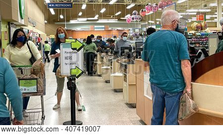 People Waiting In Line To Purchase Lottery Tickets At A Publix Grocery Store