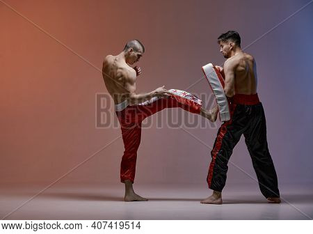 Sparring Of Boxers Two Fighting Males In Boxing Gloves During Battle, Martial Arts, Mixed Fight Conc