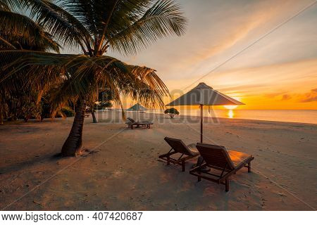 Beautiful Sunset Beach Scene. Chairs On The Sandy Beach Near The Sea. Couple Romance, Love, Honeymoo