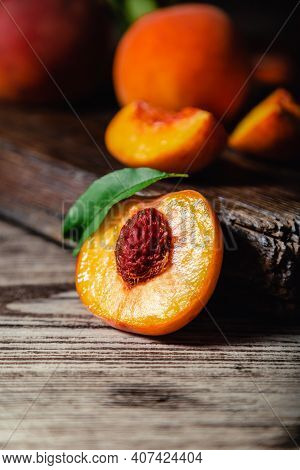 Peach With Leaf On Wooden Table. Peaches In Half. Ripe Juicy Peaches. Harvest Of Peaches For Food Or