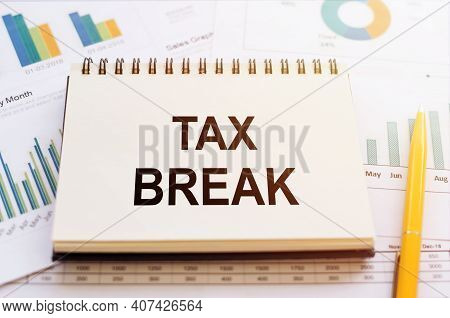 Tax Break - Written On Notepad On Financial Charts And Graphs With Yellow Pen.
