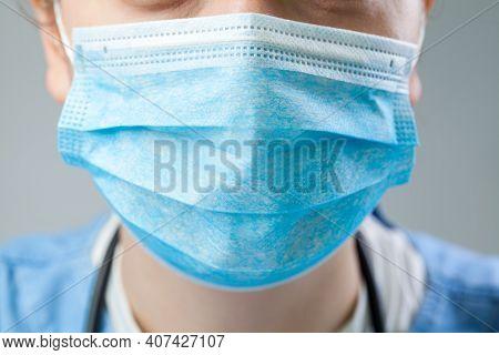 Caucasian Doctor Or Nurse Wearing Blue Protective Surgical Face Mask, Closeup Detail, Coronavirus Co