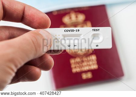 Person Holding Covid-19 Serological Rapid Diagnostic Test,at Home Or Point Of Care Testing Procedure