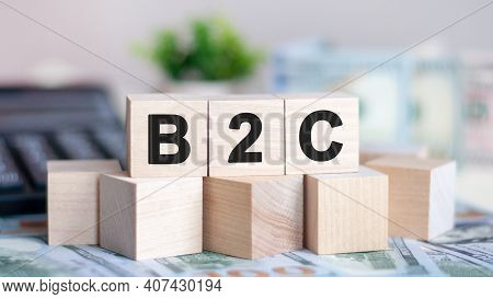 Concept Word B2c On Wooden Blocks On Beautiful Background From Green Flower. The Word B2c On Wood Cu