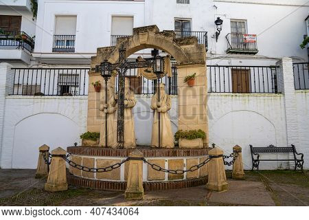 Arcos De La Frontera, Spain - 28 January, 2021: Fountain And Statues Of The Spanish Inquisition In T