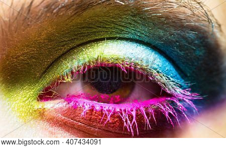 Eye With Colorful Neon Paint Fashion Makeup. Holi, Paint Party, Colors Festiva