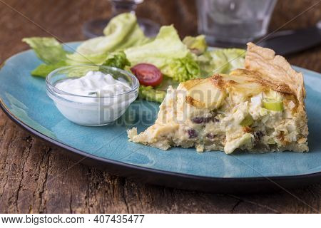 French Quiche Lorraine With Salad On Wood