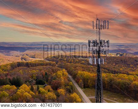 Aerial View Of Mobile Phone Cell Tower Over Forested Rural Area Of West Virginia To Illustrate Lack