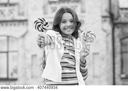 Happy Childrens Day. Small Girl Has Curly Hair. Spring Holiday Mood. Little Beauty In Positive Mood.