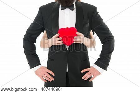 You Are My Heart And My Soul. Female Hands Hold Heart Red Toy Symbol Of Love In Front Of Man In Tuxe