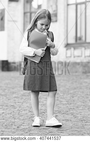 Little Child In Formal Uniform Hold School Books Outdoors, Library.