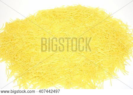 Yellow Heap Of Vermicelli Pasta Isolated On White Background