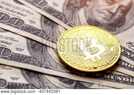 Golden Bitcoin Lies On The Banknotes.new Virtual Money. Crypto Currency Top View. Real Coins Of Bitc