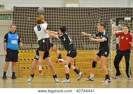 SIOFOK, HUNGARY - JANUARY 5: Unidentified players in action at a Hungarian National Championship handball match Siofok KC (black) vs. Budapest SE (white) January 5, 2013 in Siofok, Hungary.