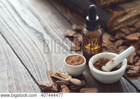 Pine Bark, Tincture Or Oil Bottle, Mortars Of Powdered Pine Bark And Old Books On Background. Copy S