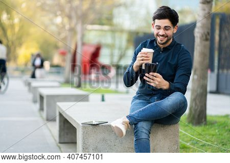 Portrait Of Young Man Using His Mobile