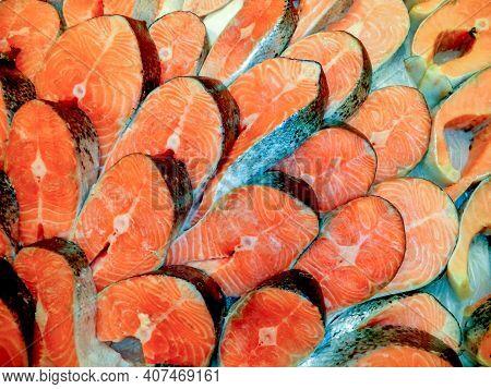 Salmon Red Fish Steak At Supermarket. Raw Fresh Salmon Steak Background. Big Heap Of Fish Meat With