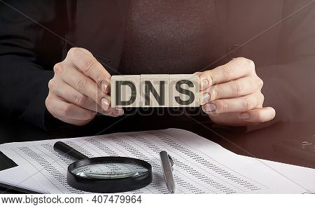 Businesswoman Holding Wooden Block With Text Dns , Business