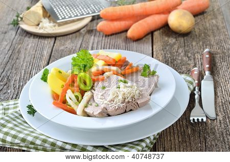 Boiled pork with mixed root vegetables and fresh horseradish - a typical Austrian recipe, so-called 'Steirer Wurzelfleisch' poster