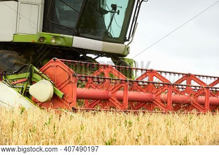 The Harvest Of Grain. The Threshing Drum Of The Combine Harvester Close-up. Selective Focus. Copy Sp