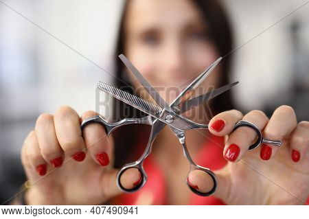 Hairdresser Holds Working Scissors With Comb In His Hands. Training Courses For The Profession Haird