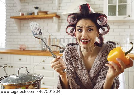 Funny Inexperienced Housewife Feeling Stressed And Helpless While Cooking A Meal