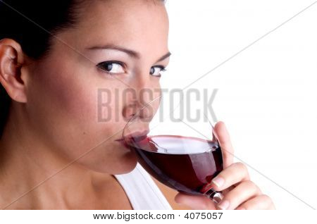 Young Woman Sipping Wine