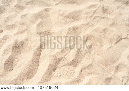 Sand On The Beach For Background. Brown Beach Sand Texture As Background. Close-up Image.