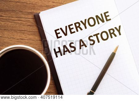 Everyone Has A Story - Text On Notepad On Wooden Desk.