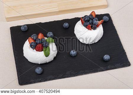 Cake Anna Pavlova. Meringue Cake With Strawberries And Blueberries. Berry Dessert Close Up.
