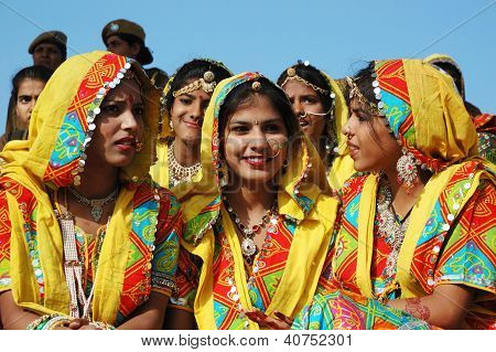 Rajasthani school girls are preparing to dance perfomance at annual camel fair holiday,Pushkar